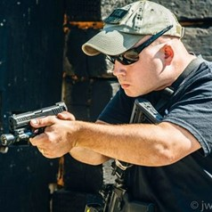 Rich Hart Shooting Instructor Holding Gun